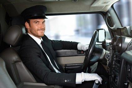 chauffeur driving limousine