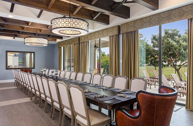 dining/conference room has a large table with seating for 32